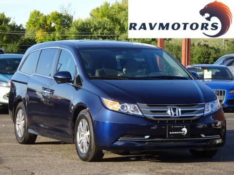 2015 Honda Odyssey for sale at RAVMOTORS in Burnsville MN