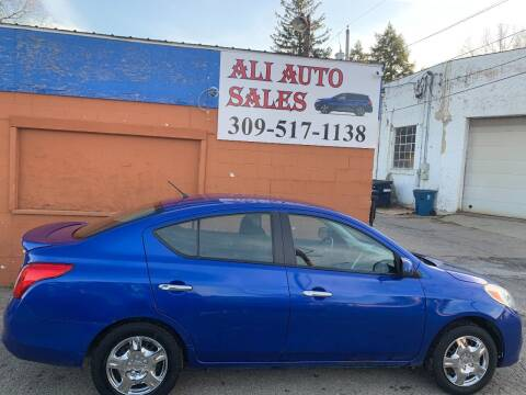 2013 Nissan Versa for sale at Ali Auto Sales in Moline IL