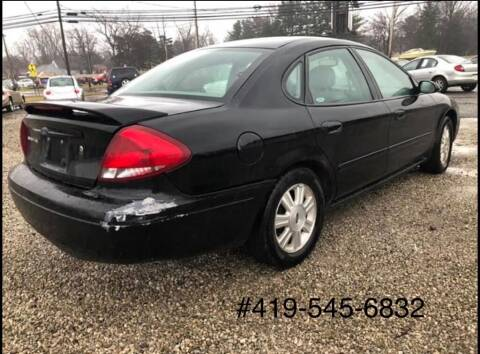 2005 Ford Taurus for sale at KRIS RADIO QUALITY KARS INC in Mansfield OH