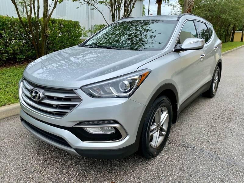 2018 Hyundai Santa Fe Sport for sale at DENMARK AUTO BROKERS in Riviera Beach FL