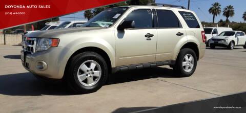 2010 Ford Escape for sale at DOYONDA AUTO SALES in Pomona CA