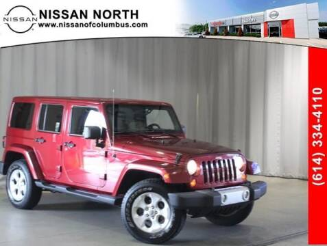 2013 Jeep Wrangler Unlimited for sale at Auto Center of Columbus in Columbus OH