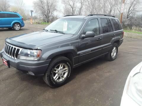 2003 Jeep Grand Cherokee for sale at BARNES AUTO SALES in Mandan ND