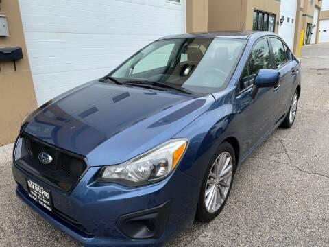 2012 Subaru Impreza for sale at REDA AUTO PORT INC in Villa Park IL