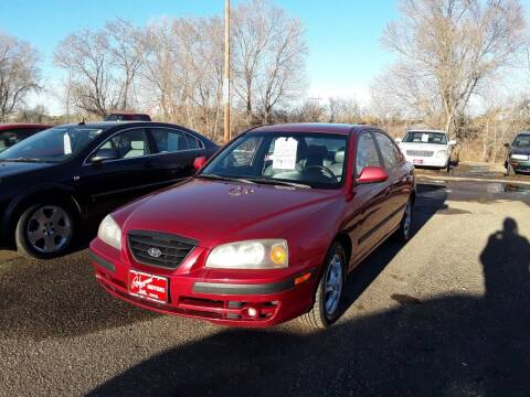 2004 Hyundai Elantra for sale at BARNES AUTO SALES in Mandan ND