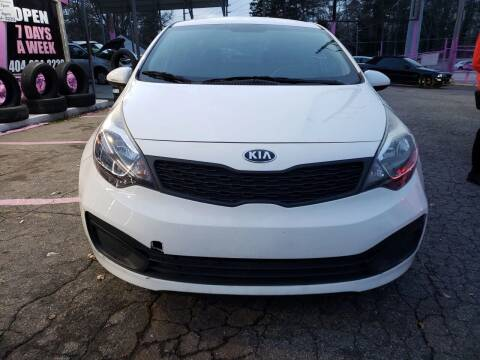 2015 Kia Rio for sale at Fast and Friendly Auto Sales LLC in Decatur GA