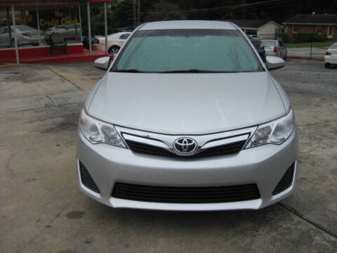 2014 Toyota Camry for sale at LAKE CITY AUTO SALES in Forest Park GA
