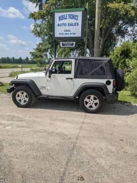 2010 Jeep Wrangler for sale at Mobile-tronics Auto Sales in Avoca MI