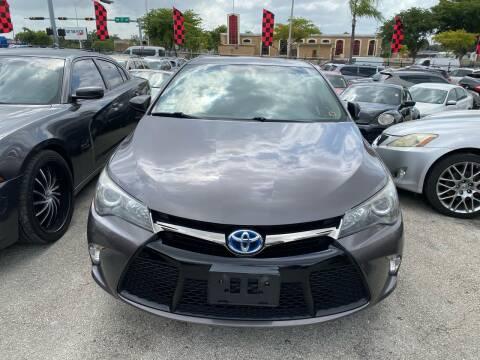 2015 Toyota Camry Hybrid for sale at America Auto Wholesale Inc in Miami FL