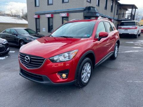 2016 Mazda CX-5 for sale at Sisson Pre-Owned in Uniontown PA