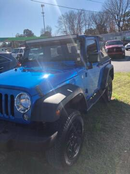 2015 Jeep Wrangler for sale at BRYANT AUTO SALES in Bryant AR