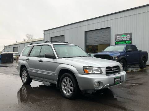 2005 Subaru Forester for sale at DASH AUTO SALES LLC in Salem OR