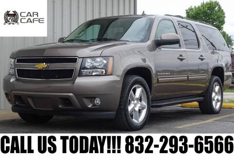 2011 Chevrolet Suburban for sale at CAR CAFE LLC in Houston TX