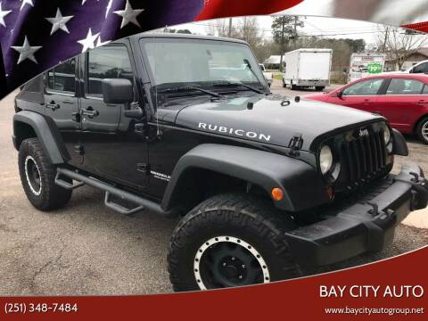 2009 Jeep Wrangler Unlimited for sale at Bay City Auto's in Mobile AL