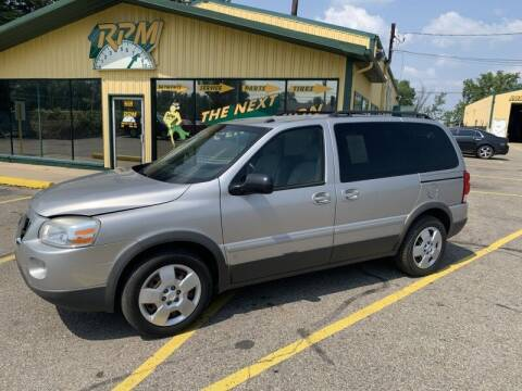 2009 Pontiac Montana for sale at RPM AUTO SALES in Lansing MI