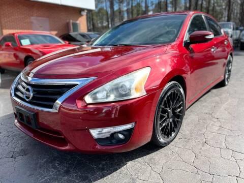 2014 Nissan Altima for sale at Magic Motors Inc. in Snellville GA