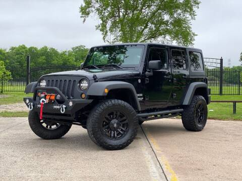 2013 Jeep Wrangler Unlimited for sale at Texas Auto Corporation in Houston TX
