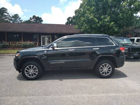 2014 Jeep Grand Cherokee for sale at Victory Motor Company in Conroe TX