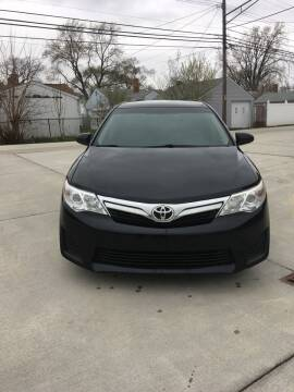 2012 Toyota Camry for sale at Suburban Auto Sales LLC in Madison Heights MI