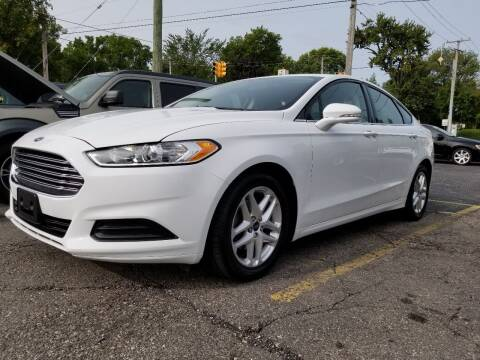2016 Ford Fusion for sale at DALE'S AUTO INC in Mount Clemens MI