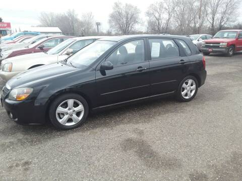 2009 Kia Spectra for sale at BARNES AUTO SALES in Mandan ND