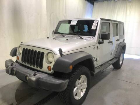 2009 Jeep Wrangler Unlimited for sale at The Car Store in Milford MA
