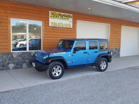 2010 Jeep Wrangler Unlimited for sale at MARIETTA MOTORS LLC in Marietta OH