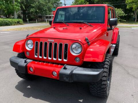 2016 Jeep Wrangler Unlimited for sale at LUXURY AUTO MALL in Tampa FL