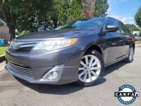 2012 Toyota Camry for sale at Carma Auto Group in Duluth GA