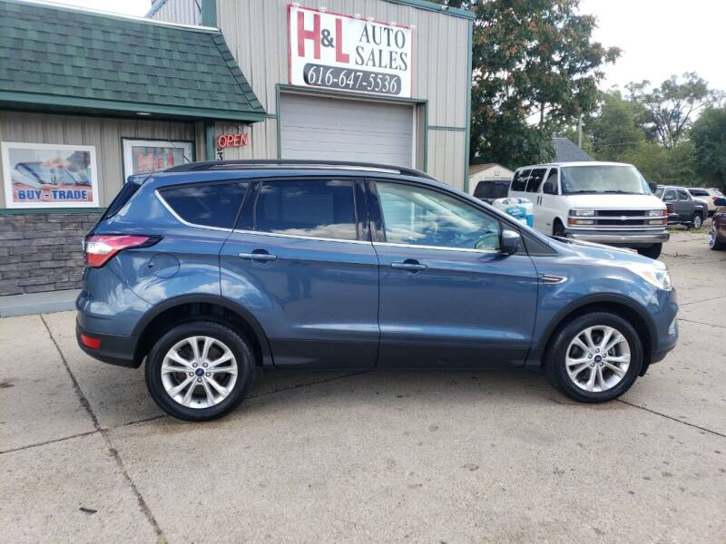 2018 Ford Escape for sale at H & L AUTO SALES LLC in Wyoming MI