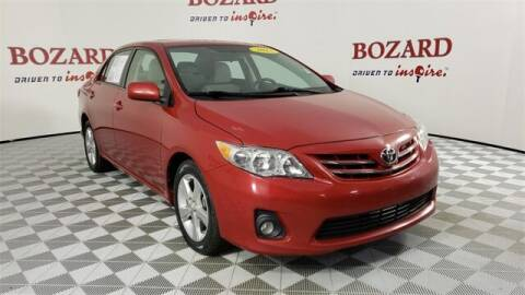 2013 Toyota Corolla for sale at BOZARD FORD in Saint Augustine FL