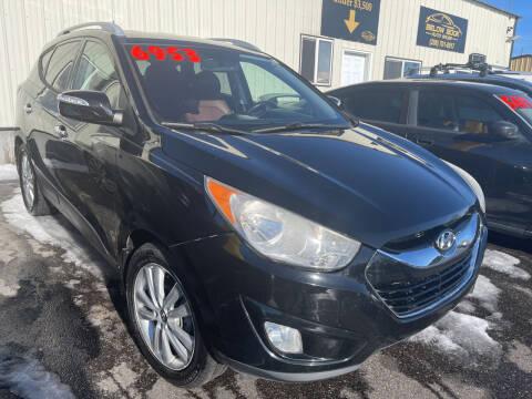 2011 Hyundai Tucson for sale at BELOW BOOK AUTO SALES in Idaho Falls ID
