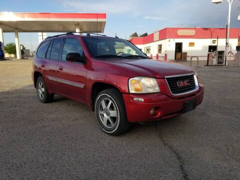2005 GMC Envoy for sale at KHAN'S AUTO LLC in Worland WY