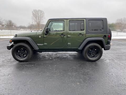 2009 Jeep Wrangler Unlimited for sale at Caruzin Motors in Flint MI