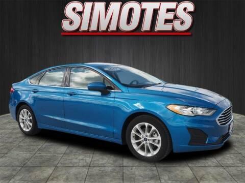 2019 Ford Fusion for sale at SIMOTES MOTORS in Minooka IL