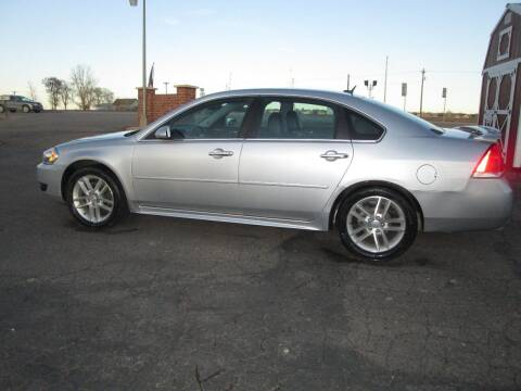 2013 Chevrolet Impala for sale at STEVES ROLLIN STONE AUTO SALES in Eaton CO
