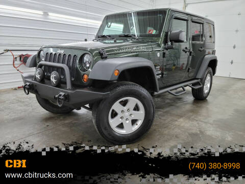 2011 Jeep Wrangler Unlimited for sale at CBI in Logan OH