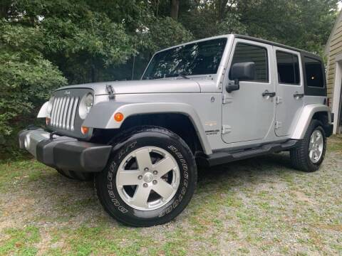 2011 Jeep Wrangler Unlimited for sale at MEE Enterprises Inc in Milford MA