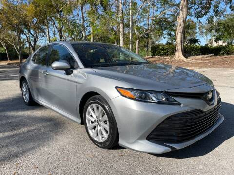 2019 Toyota Camry for sale at DELRAY AUTO MALL in Delray Beach FL