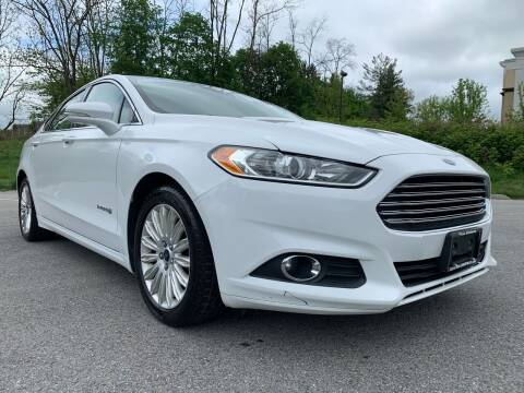 2015 Ford Fusion Hybrid for sale at Auto Warehouse in Poughkeepsie NY