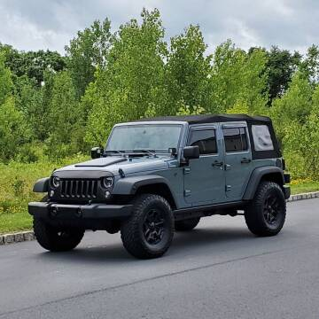 2014 Jeep Wrangler Unlimited for sale at R & R AUTO SALES in Poughkeepsie NY