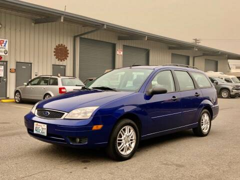 2006 Ford Focus for sale at DASH AUTO SALES LLC in Salem OR