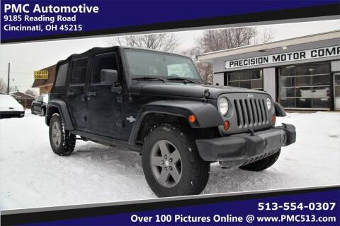 2013 Jeep Wrangler Unlimited for sale at PMC Automotive in Cincinnati OH