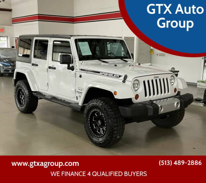 2013 Jeep Wrangler Unlimited for sale at GTX Auto Group in West Chester OH