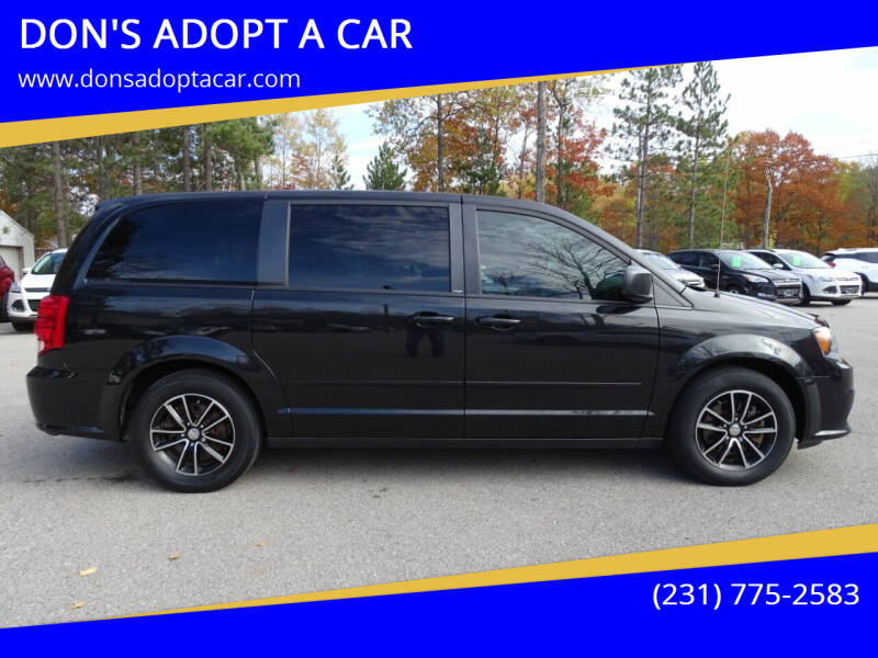 2014 Dodge Grand Caravan for sale at DON'S ADOPT A CAR in Cadillac MI