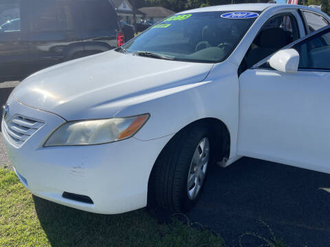 2007 Toyota Camry for sale at Cars for Less in Phenix City AL