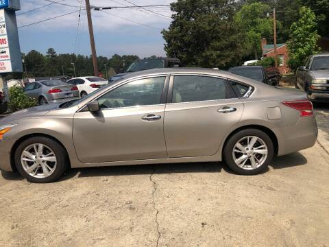 2013 Nissan Altima for sale at Moore's Motors in Durham NC