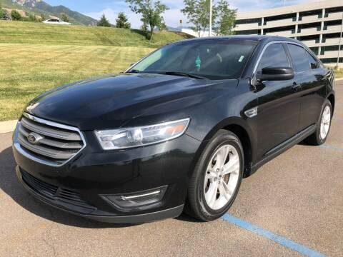 2014 Ford Taurus for sale at DRIVE N BUY AUTO SALES in Ogden UT