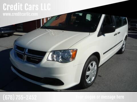 2013 Dodge Grand Caravan for sale at Credit Cars LLC in Lawrenceville GA
