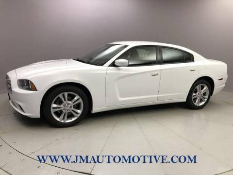 2013 Dodge Charger for sale at J & M Automotive in Naugatuck CT